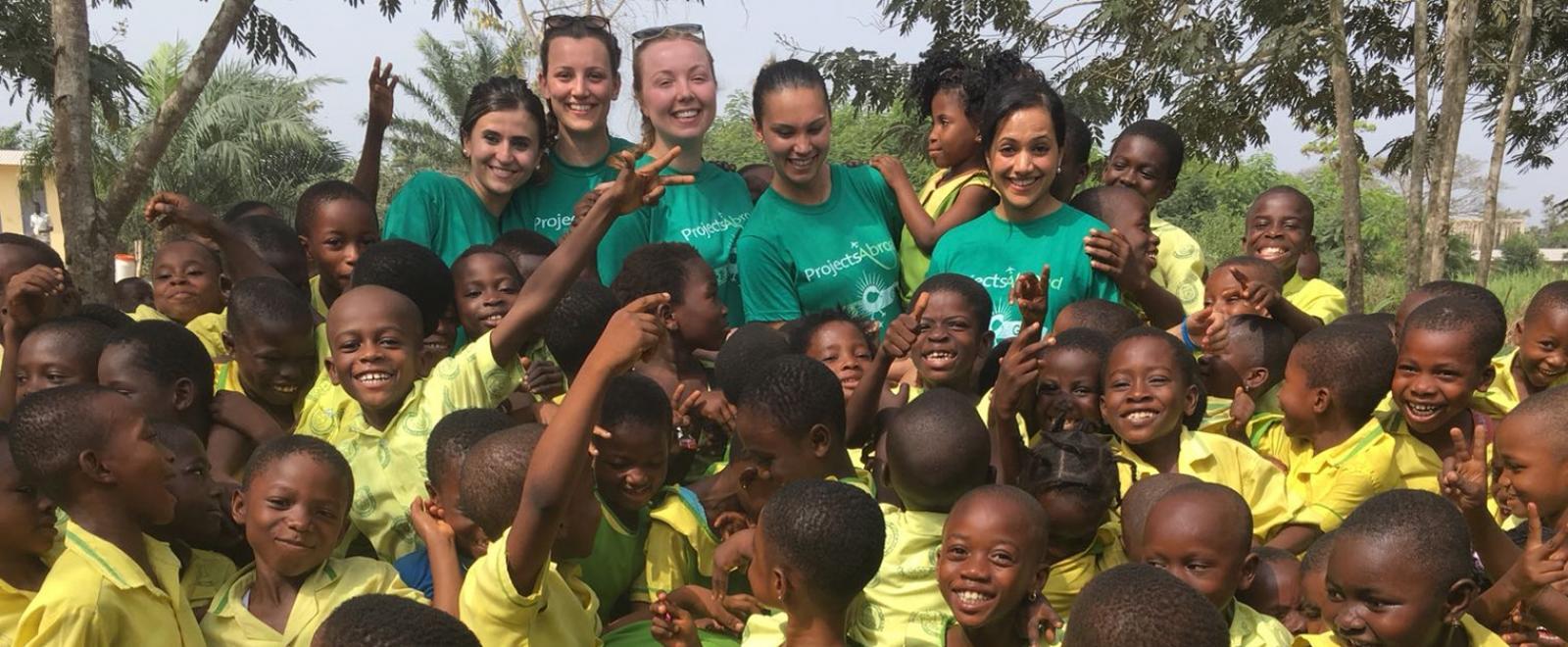 Medical volunteers working with children in Ghana